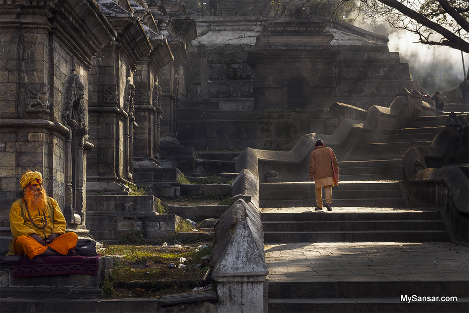 Daily life of a Sadhu sitting on one of the shrine waiting for tourist to take their picture and earn money from tourist at Pashupatinath temple followed by a hindu brahmin walking towards Guheshwori temple and a man reading newspaper.  Chemi Dorje