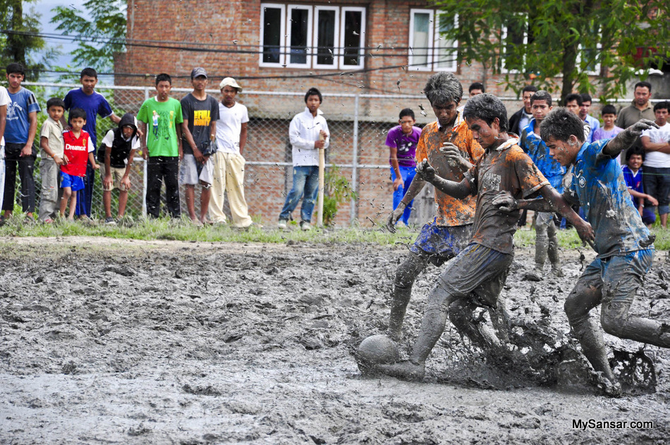 Passion for the GAME Players of Janasewa Higher Secondary School 'B' and a player of Laboratory Higher Secondary School playing Final Game of Oscar cup 2068 organized by Panga Youth Forum in premises of Janasewa Higher Secondary School, Panga on 20 August, 2011, Due to the heavy rain the ground was full of mud.  Photo: Narayan Maharjan