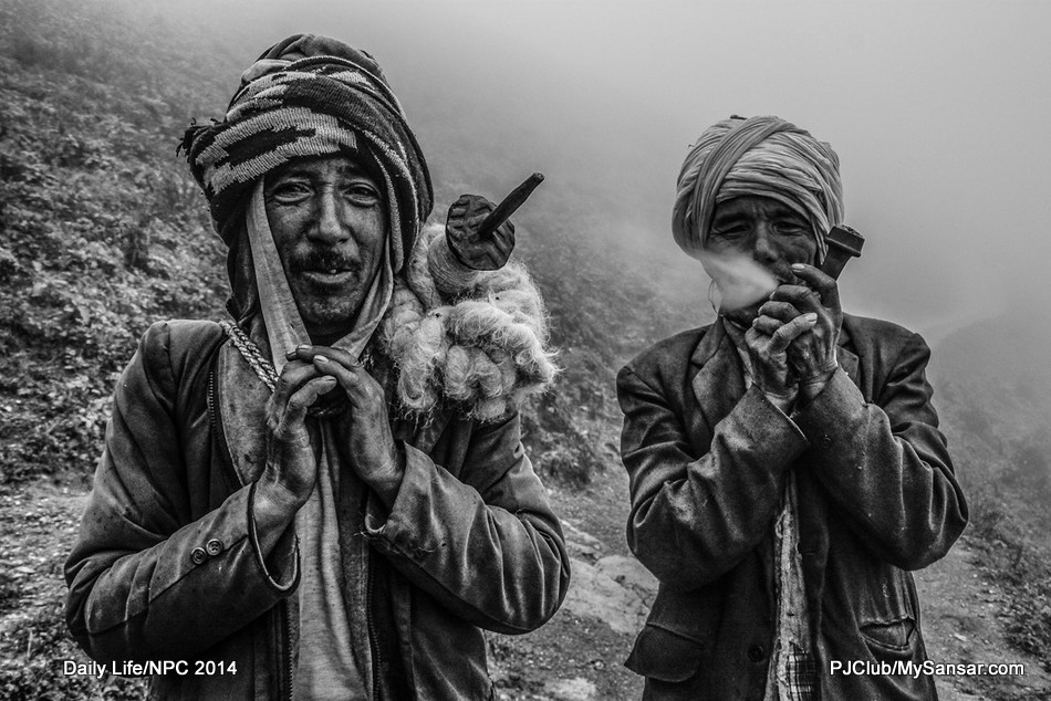 Caravan is a way of life for many people who dwell with their livestock in the Himalaya. Smoking chillum for these two shepherds from Mugu is a daily affair. Photo: Kaushal Raj Sapkota