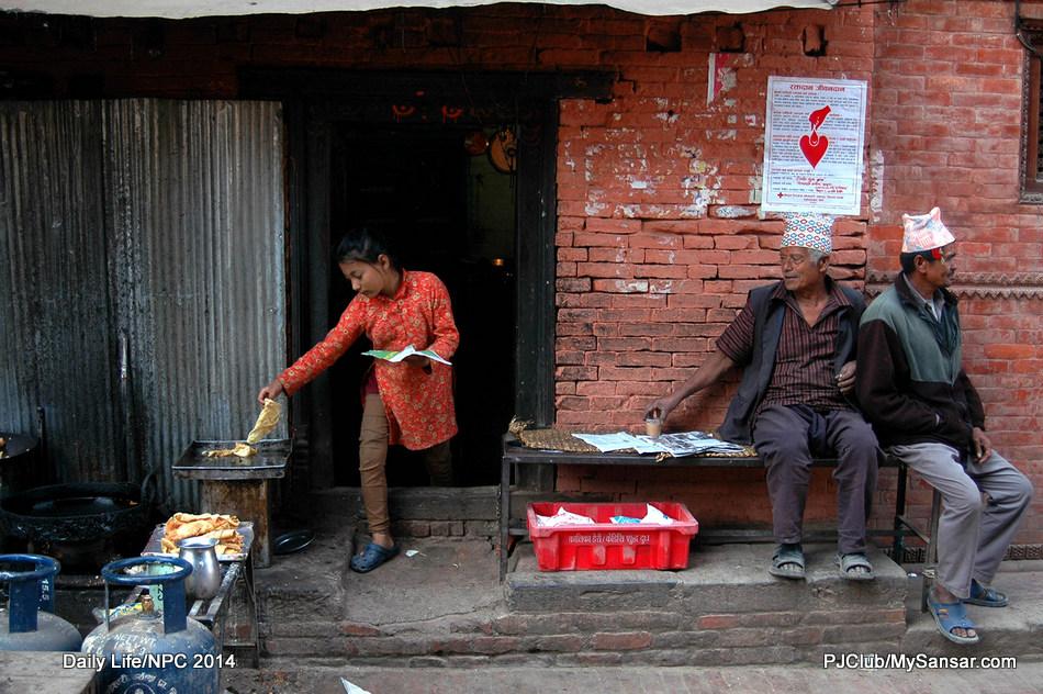 A young girl readies the orders of customers in a small sweetshop in Dattatreya Square, Bhaktapur.  Photo: Bibek Raj Shrestha