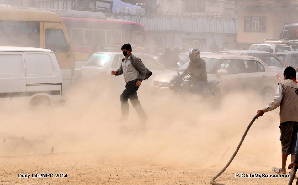 A pedestrian struggles his way through the Maitighar-Koteswar road. The road expansion drive around town has been poorly managed and has only contributed to air pollution and heavy smog. Photo: Nimesh Jang Rai