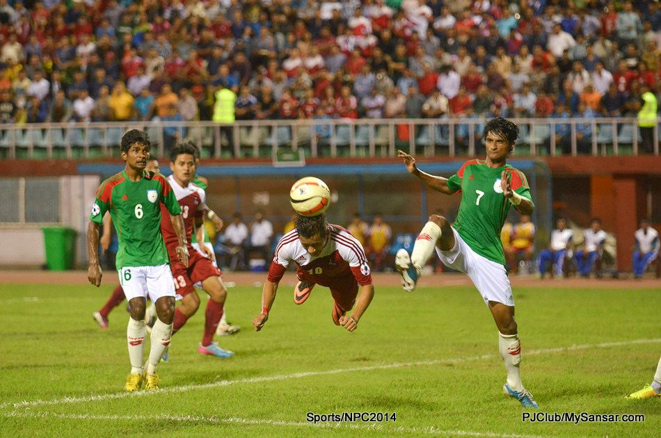 National Football Team's Captain Anil Gurung attempts a header which was later converted to a goal by Bharat Khawas during the SAFF Championship hosted by Nepal. Photo: Pemba Sherpa.