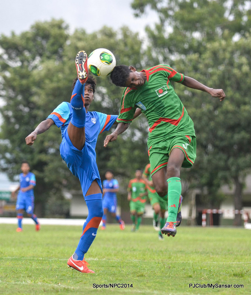 Players from Bangladesh and India struggle it out for possession of the ball. Photo: Pemba Sherpa