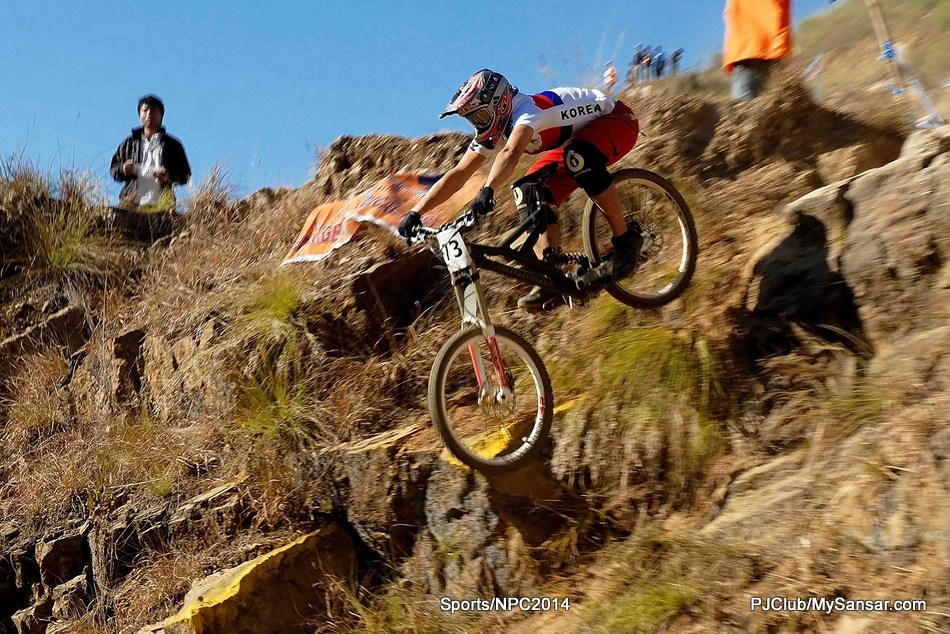 A Korean cyclist attempts an extreme downhill in an international downhill challenge hosted by Nepal. Photo: Shankar Bir Byanjankar