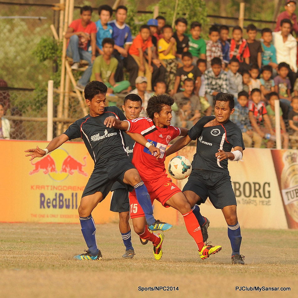 ANFA Dharan (black) and Nepal Police Club's players struggle for the possession of the ball during their match in the 16th Budha Subba Gold Cup hosted by ANFA Dharan. Photo: Yatra Thulung Rai