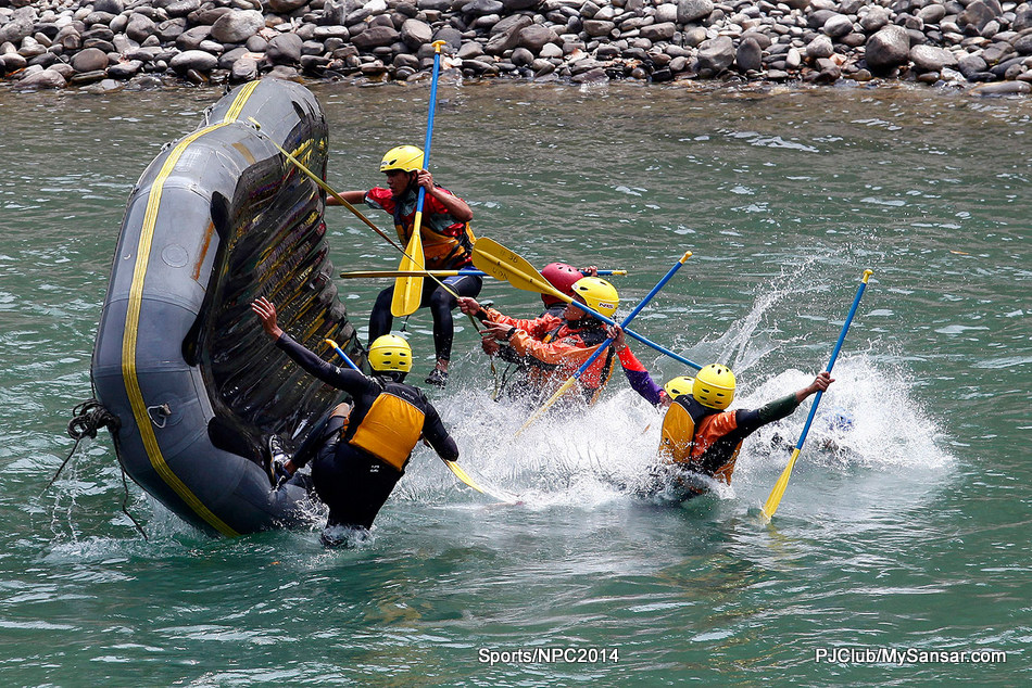 River guide trainees practice raft flip drills during a white water rafting course in the Sunkoshi River. Nepal is a popular destination for water adventure sports. Photo: Kiran Panday.