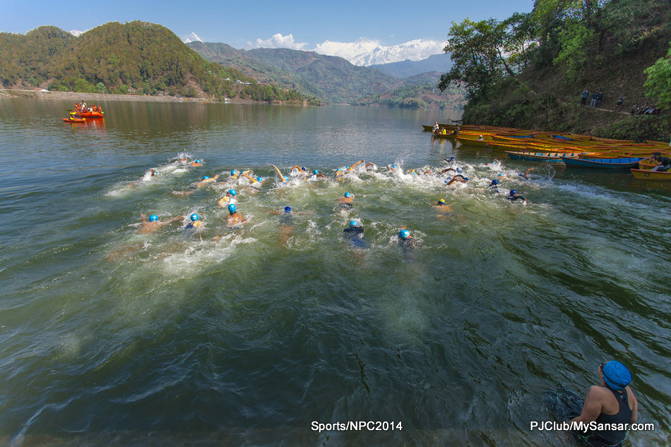 A participant takes her time before taking a dive in the Begnas Taal during the Himalayan Rush International Triathlon Championship. Photo: Nischal Oli