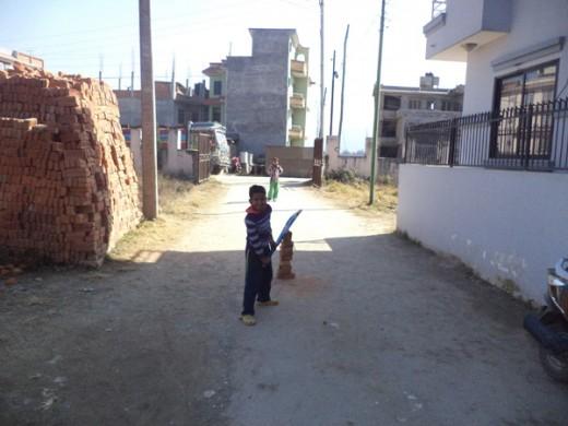3 Children playing while kiln operating