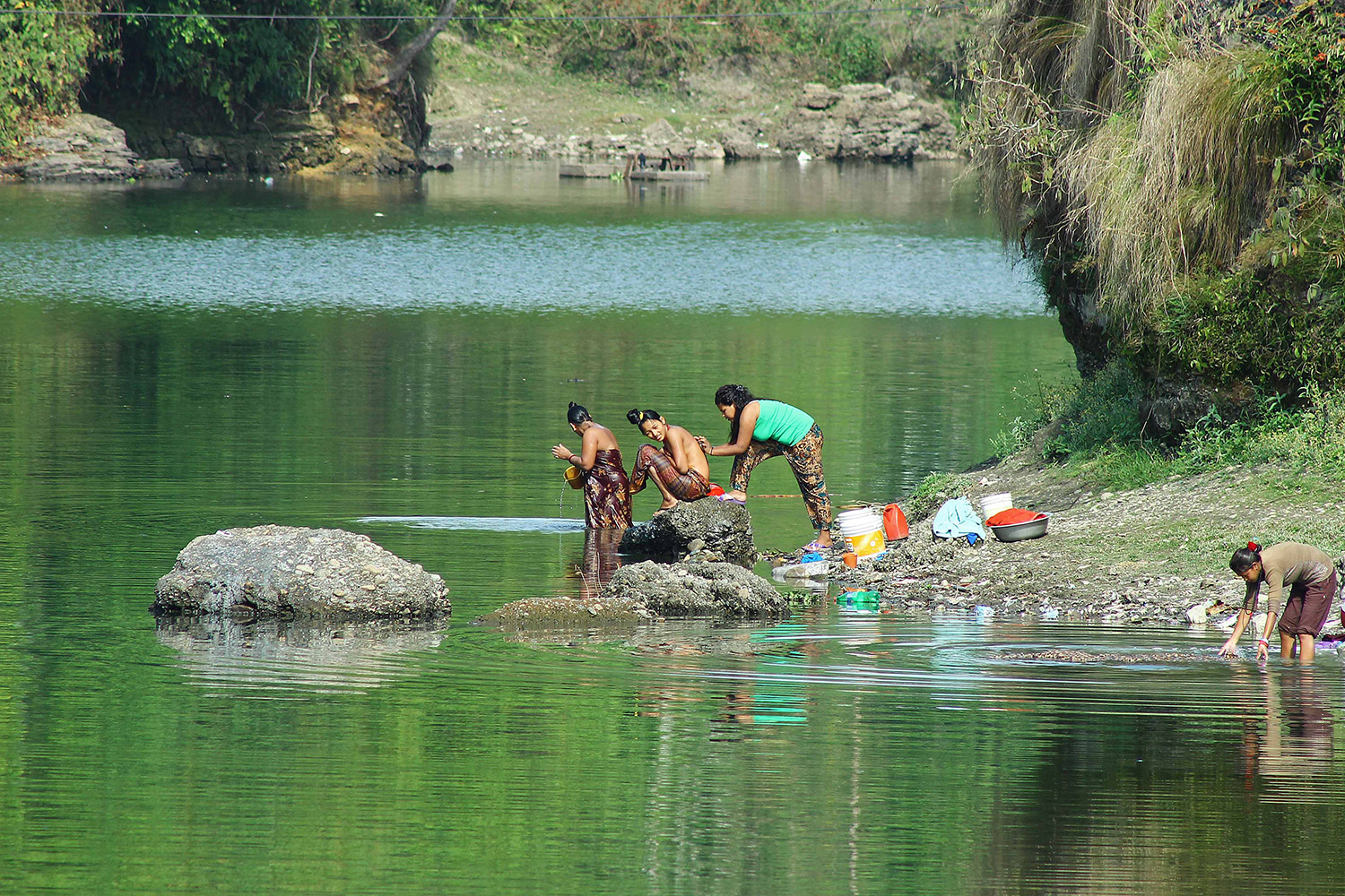 Despite restrictions to bathe and wash laundry in Phewa Taal, awareness to safeguard the ecological sanctity of the lake seems to have made no progress. Photo: Samir Baral