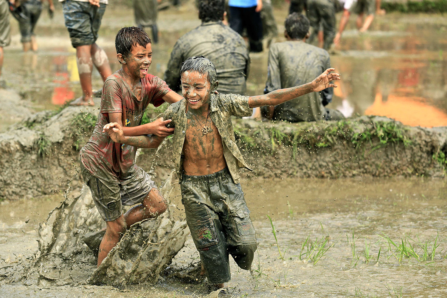 Two boys play in the mud during Asar 15 celebrations. Photo: Aaditya Chand