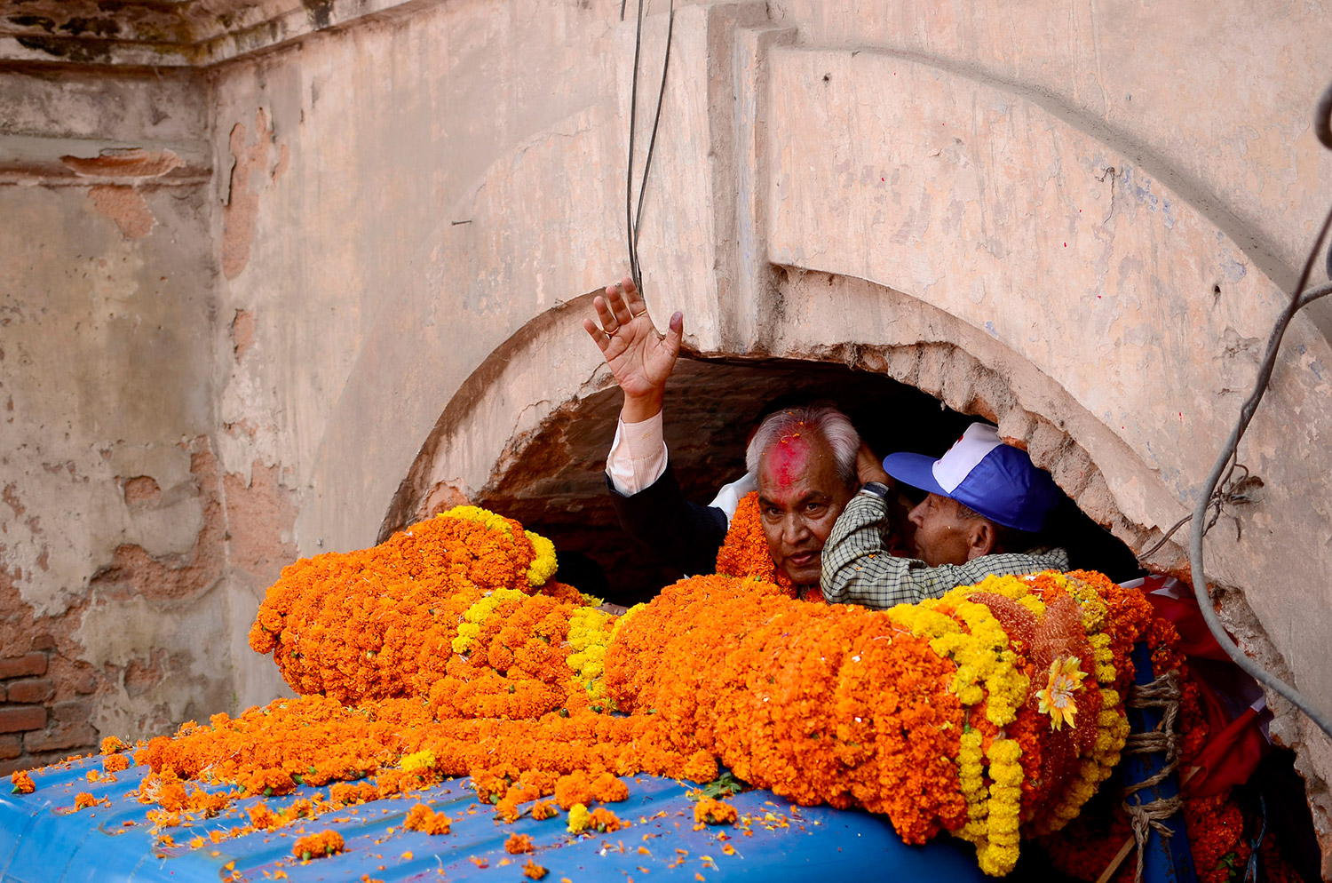 Supporters of Khum Bahadur Khadka celebrate his release from prison with a garland weighing 111 kg. Khadka had served 14 months in prison after he was found guilty of abusing his power as the minister for Physical Planning and Works by embezzling a huge amount of state fund. October 2013. Photo: Prakash Lama