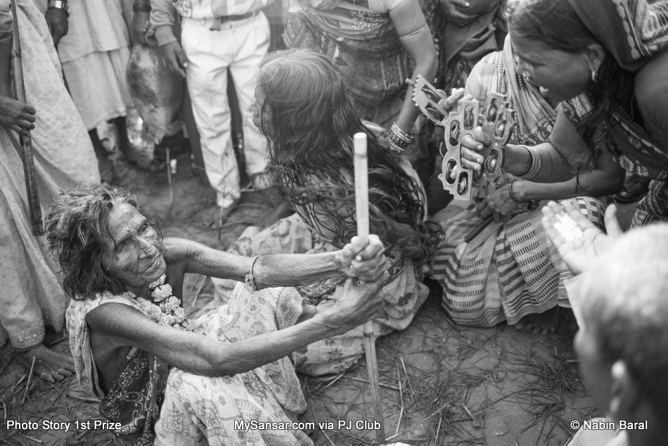 """Kanti Yadav a is scorned  and ridiculed by a group of people led by dhamis during a pilgrimage to Kamala River for the """"Ghost Festival"""" for the supposed clearing of evil spirits."""