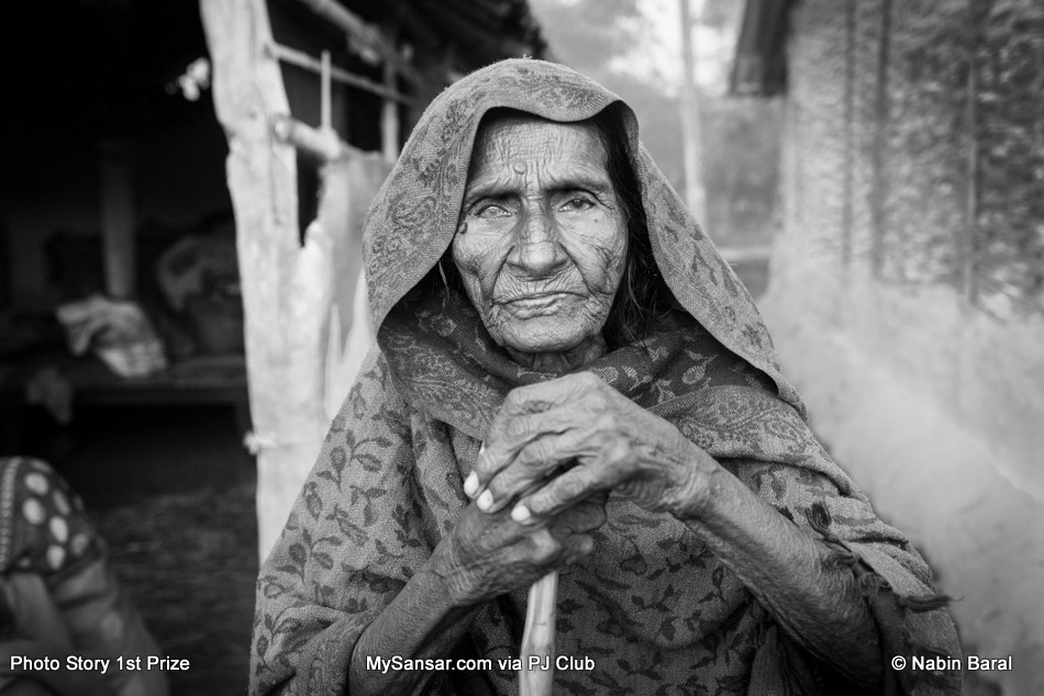 Kanti Yadav, a 103 year old widow from a village of Janakpur  Dristrict. The Dhami of the same village blames Brikeah Yadav's illness on her.  November 5 2014, Janakpur, Nepal.