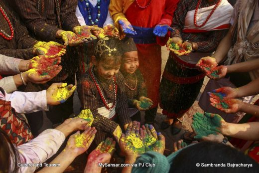 people of different ethnic groups celebrating the festival of colors, Holi.