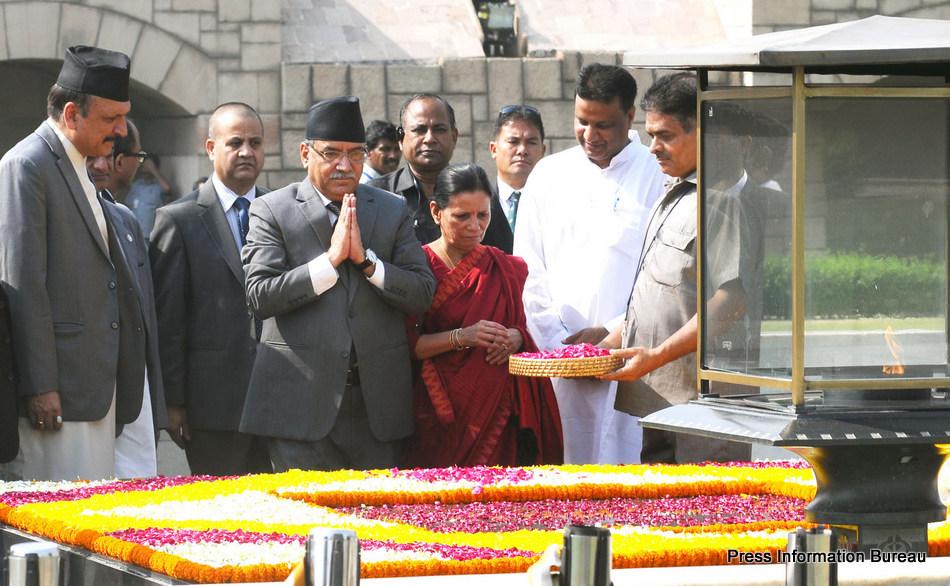 The Prime Minister of Nepal, Mr. Pushpa Kamal Dahal paying homage at the Samadhi of Mahatma Gandhi, at Rajghat, in Delhi on September 16, 2016.