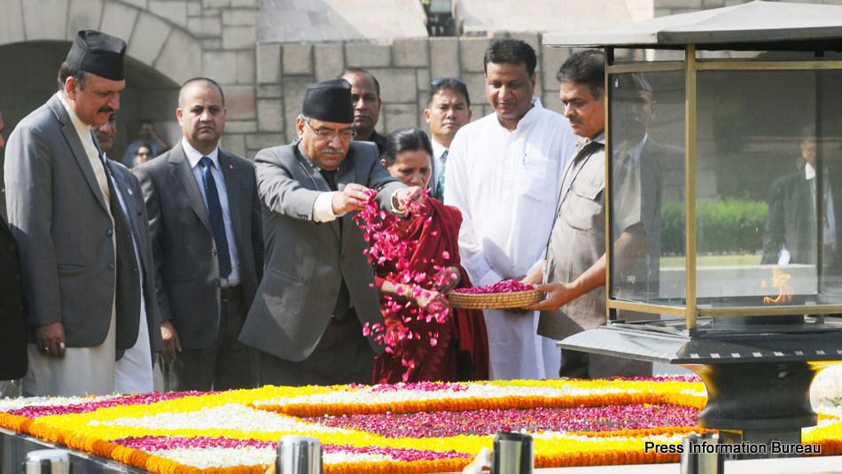 The Prime Minister of Nepal, Mr. Pushpa Kamal Dahal paying floral tributes at the Samadhi of Mahatma Gandhi, at Rajghat, in Delhi on September 16, 2016.